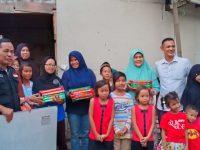 Komil dan Metal Distribusikan Al-qur'an ke TPQ Nurul Ikhsan