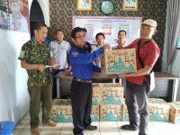 Forum Wartawan Kompeten Kabupaten Pringsewu (FWK-KP) serahkan Bingkisan dan Kupon Daging Sapi Untuk Anggota